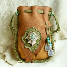 The green lacing makes this medicine bag pop. Love the works in Pradoleather's Etsy shop. Native American style Medicine Bag with antler burr and turquoise.