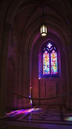 stained glass windows radiate purple hues