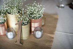 DIY spray painted gold & brass tins with baby's breath & burlap | Erin & David's DIY, budget-friendly Northern Virginia wedding with a neutral color palette & pop of red! Images by Kristen Gardner Photography.