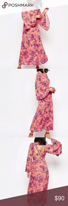 """1DAY SALE FP Melrose Bell Sleeve Dress NWOTSZ4 Boatneck - Long bell sleeves - Cutout back with crisscross straps - Concealed side zip closure for easy dress - Allover print - Partially lined - Approx. 52"""" length - Imported Free People Dresses Maxi"""