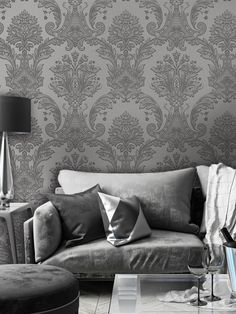 This stunning Amara Damask wallpaper will bring a touch of style and elegance to your home. The design features an intricate embossed damask pattern in a gunmetal grey tone on a lightly textured silver background, with a beautiful soft sheen finish to catch the light. Easy to apply, this high quality vinyl wallpaper would look great as a feature wall or equally good when used to decorate a whole room. Damask Wallpaper, Paper Wallpaper, Vinyl Wallpaper, Lounge, Colours, Touch, Bedroom, Grey, Silver