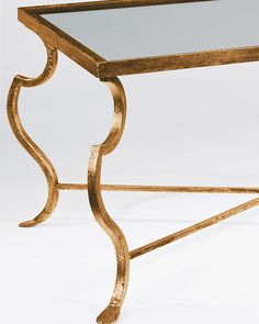 rectangular wrought iron coffee table with distressed antiqued gold-leaf finish and glass top