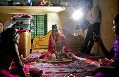MANIKGANJ, BANGLADESH - AUGUST 20: 15 year old Nasoin Akhter poses for a video on the day of her wedding to a 32 year old man, August 20, 2015 in Manikganj, Bangladesh.  In June of this year, Human Rights Watch released a damning report about child marriage in Bangladesh. (Photo by Allison Joyce/Getty Images)