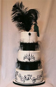 So elegant, I would hate to be the one who cuts the first slice. LOVE the raven on top!