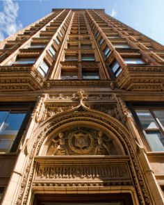 The 18-story gothic-inspired Fisher Building designed by Charles Atwood of Burnham & Co. is distinguished by its richly detailed golden terra cotta façade with fantastical depictions of sea life that allude to the name of the developer, Lucius Fisher. The high percentage of glass on the facade, groundbreaking at the time, foreshadows the amount of glass we have come to expect on modern .