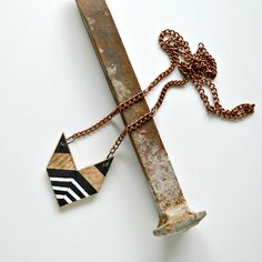 Yuchi Zebra Arrowhead Chevron Geometric Tribal Necklace in Black, Metallic Gold, and White. $15.00, via Etsy.