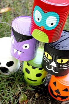 Paint cans with theme, and turn them into a game.  These are Halloween, but it could be any season or theme.  You just need a soft ball, like an old tennis ball, and you can play knock 'em down.  Or lay them out on the lawn and roll a big ball at them. (no link)