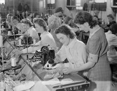 Wartime Sewing. Beautiful ladies in fashion manufacturing factory. For manufacturing tips and how to create your products, read on www.insider.utelier.com