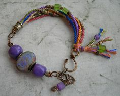 March ABS by BlueQuailDesign using a lampwork focal bead by Naos glass