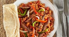 Make fajitas heartier by adding Zatarain& Spanish Rice to the filling of sauteed beef, bell peppers and onions. It's a quick and easy dinner idea for the whole family. Rice Recipes, Meat Recipes, Mexican Food Recipes, Low Carb Recipes, Ethnic Recipes, Spanish Rice Recipe, Fajita Recipe, Family Meals, Family Recipes