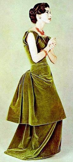 Moss-green velvet dress gathered in slight bustle, by Gres, coral and gold jewelry by Cartier, 1957 <3