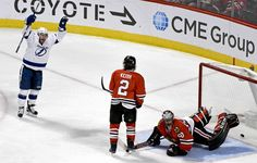 Blackhawk down:   Tampa Bay Lightning center Tyler Johnson, left, celebrates after scoring his second goal against Chicago Blackhawks goalie Corey Crawford, right, as defenseman Duncan Keith looks on during the third period on Jan. 24 in Chicago. The Lightning won 5‐2.