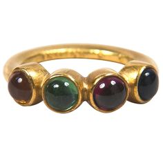 Multicolored Cabochon Stones Gold Ring Presented by Carol Marks | From a unique collection of vintage band rings at https://www.1stdibs.com/jewelry/rings/band-rings/