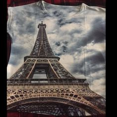 "Eiffel Tower Novelty Shirt Fun image graphic short sleeve shirt. One size fits most. Measurements vary slightly from shirt to shirt with smallest at approximately 23"" length from front collar to hemline, bust 23"", waist 19"". Bust and waist measurements taken with garment laid flat and measuring across. Fabric is thin and light. Novelty shirt. Brand new retail w/o tags. ⚠️Measurements are approximations and vary some from shirt to shirt.      PRICE IS FIRM UNLESS BUNDLED❗️         No offers…"