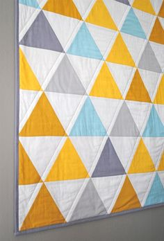 Yellow, gray and blue simple quilt.