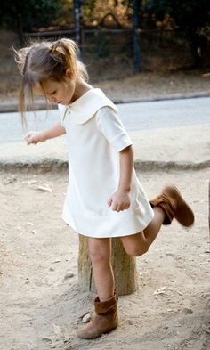 Fashion kid. Girl. White dress. Boots.
