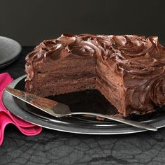 Triple Layer Brownie Cake Recipe -A little of this tall, rich brownie cake goes a long way, so you'll have plenty of pieces left to share with grateful family members and friends. It's a sure way to satisfy true chocolate lovers and is perfect for any occasion. -Barbara Dean, Littleton, Colorado