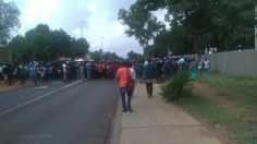 Pretoria - Hundreds of Tshwane University of Technology students have shut down academic proceedings again at the institution's Soshanguve North and South campuses this morning.   The students carrying sticks left a burning tyre at the main gate of the north campus and marched to he south campus surrounded by numerous police vehicles deployed to maintain order.