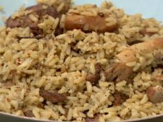 Get this all-star, easy-to-follow Cajun Chicken and Sausage Jambalaya recipe from Throwdown with Bobby Flay