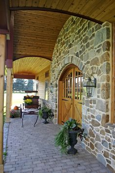Siding, Roofing & Stone- natural stone entry and wainscot, tumbled brick pavers with soldier course (no mortar)