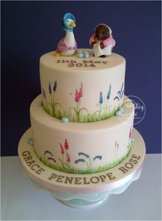 Beatrix Potter Christening Cake A two tier (bottom chocolate, top vanilla) cake covered with vintage ivory sugarpaste and. Cute Cakes, Pretty Cakes, Christening Cake Girls, Christening Cakes, Beatrix Potter Cake, Peter Rabbit Cake, Girl Cakes, Baby Cakes, Edible Cake Toppers