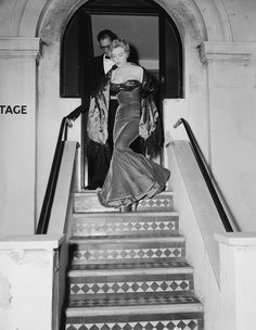 """Marilyn Monroe and husband Arthur Miller leaving the Comedy Theatre in London after a performance of Millers play """"A View from the Bridge"""", 1956"""