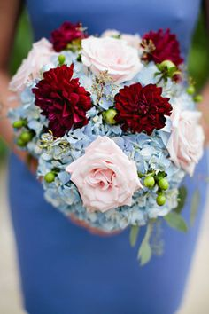 A cornflower blue bridesmaid dress looks so lovely with this wedding bouquet: red dahlias, blush roses and blue hydrangeas. | Simple Elegance Floral & Event Design, Wisconsin