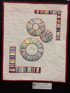 """""""So how many circles did you want?""""   Circle challenge at our local quilt guild...made with selvedges, with all the lovely circles of colour!"""