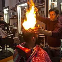 How many of you would let Ramadan Edwan of Palastine do the fire barber style on you?  #foodie #foodblogger #foodvlogger #vlogger #PTCares #fire #barber #barbershop #hair #hairstyle #flames
