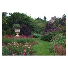 Late summer herbaceous borders with grass paths in the walled garden - Crathes Castle Garden, Aberdeenshire, Scotland