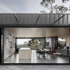 Skyline House is a black-clad house, set on a steep incline. Located in Lorne, Australia, the house was designed by Lachlan Shepherd Architects in Australian Architecture, Architecture Design, Facade Design, Residential Architecture, Carport With Storage, Skyline Homes, External Cladding, Metal Cladding, House And Home Magazine