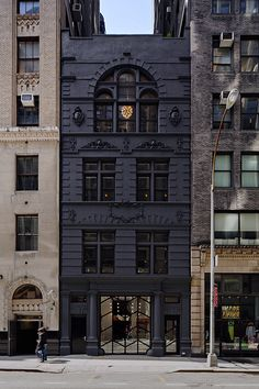 What a rebel! Take a traditional brownstone and paint it black. Makes it look darkly modern.