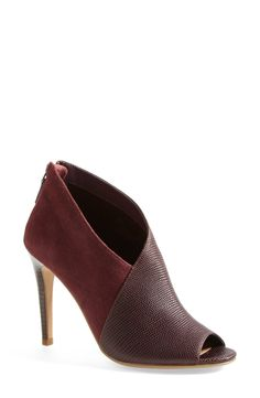 Mixed media booties for fall. Burgundy is definitely in.