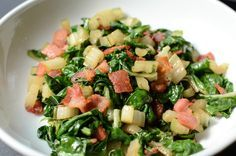 Swiss Chard with Bacon and Garlic - ButterYum  Swiss chard is my favorite dark leafy green, and my favorite way to prepare  it is to saute it with a little garlic and bacon, then add a splash of red  wine vinegar just before serving to balance the sweet and savory flavors -  oh my goodness, it's so darn good! Some people discard the stems, but I  think they add a lovely texture to the dish. If you can find rainbow  chard, buy it -the color variations make for an even more appetising dish…