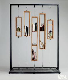 "A remanier pour faire une ""partition"" sur roulettes The lack of space for books is so astonishing that I cannot in good conscience call it a bookshelf, but it is an innovative and attractive decoration. Perhaps a room divider or window screen of sorts. Display Design, Store Design, Shelf Design, Diy Furniture, Furniture Design, Wood Furniture Store, Mirrored Furniture, Furniture Online, Decoration Evenementielle"