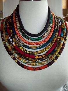 This is a 9 cord necklace created from authentic old school African prints. Each cord is cut on the bias for maximum drapabiltiy.. Back fastens