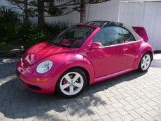 Pink Volkswagen Beetle convertible.