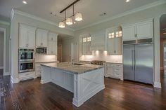 27214 Terra Run Ct Spring, TX 77386: Photo This kitchen does not disappoint when it comes to detail.  Pendant and recessed lighting, custom cabinets with glass display lighting, SS Kitchen Aid appliances include double ovens, microwave and side by side fridge.