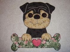 Dog Faces Quilted Wall Hangings - via @Craftsy