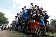 People try to board a crowded passenger train to take part in the Nat, or spirits, festival, at Taungbyone station, near Mandalay August Trains, Indian Funny, Mandalay, Train Travel, Locomotive, Travel Style, Funny Photos, Hiking Boots, Transportation