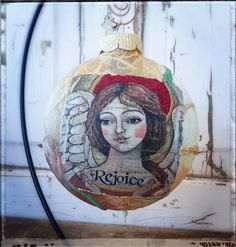 Rejoice papered ornament featuring art by Teresa Kogut