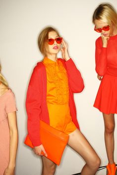 So excited for the colors of spring/summer 2012!     PS. I'm crazy about that oversized orange clutch.
