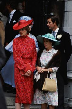 222) June 4, 1981 – Charles and Lady Diana (in a statement red dress and matching hat) at the wedding of Nicholas Soames and Catherine Weatherall at St Margaret's Church, London. Princess Margaret, had taken the young beauty under her wing.