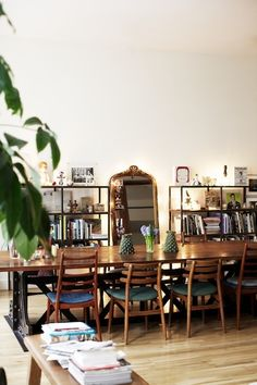 Love the shelf decor and the mismatched chairs.