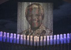 SOUTH AFRICA, QUNU : Candles are lit under a portrait of Neslon Mandela before the funeral ceremony of South African former president Nelson Mandela in Qunu on December Mandela, the revered. Military Guard, Funeral Ceremony, Africa Flag, Gil Scott Heron, Honor Guard, Nelson Mandela, Mandela Art, Lest We Forget, Former President