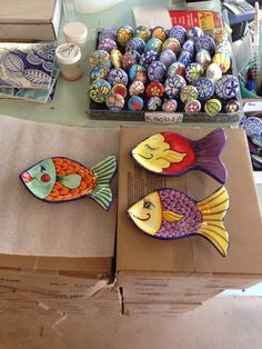Fish spoon rests painted by Tessa at Damariscotta Pottery
