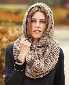 The Cable Knit Endless Loop Scarf is a cozy addition to your cold-weather ensemble. It's chunky and fashionable with an oversized hood that looks great both up and down. The hood secures with two pom-pom ties. One size fits most. Acrylic. Imported.2-in-1