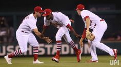 St. Louis Cardinals players (L to R) Randal Grichuk, Dexter Fowler and Stephen Piscotty celebrate a 2-1 win over the Pittsburgh Pirates at…