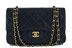 """Chanel Black Lambskin Medium-Large Classic 2.55 Double Flap Bag - The classic iconic bag of Chanel, Chanel Black Lambskin Medium-Large Classic 2.55 Double Flap Bag.   The classic 2.55 Chanel flap features a back pocket, and interior """"double"""" flap with a compartment behind the flap, a zipper compartment on the side. The double woven signature Chanel chain can be worn as a single or double strap.  This item is in very good condition with very few signs of normal use.  Interior hardware (b..."""