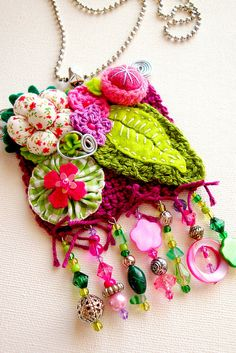amazing...combination of crocheting, felt, fabric flowers, and bling....very creative...